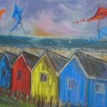 Kites over beach huts