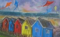 Kites over beach huts